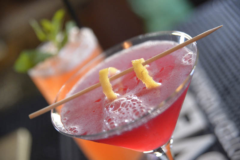 This is a photo of The Federals Signature Pink Cosmopolitan.