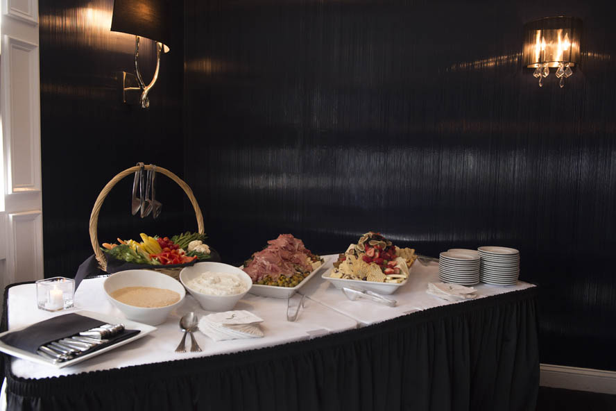 This is a photo of antipasto appetizers, and vegetables provided by the federal catering.