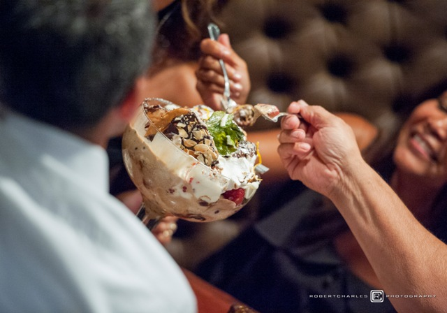 This is a photo of guests enjoying The Federal's giant sundae.