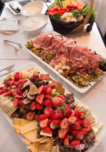 This is a photo of assorted cheese, crackers, fruits and antipasto platters from the Federals catering menu.