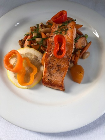 This is a photo of Salmon with gingered carrots, cannellini beans & pickled chili peppers