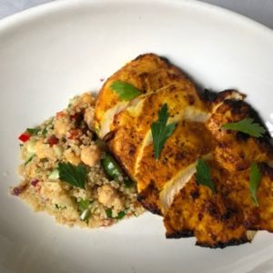This is a photo of Tandoori chicken breast with quinoa salad