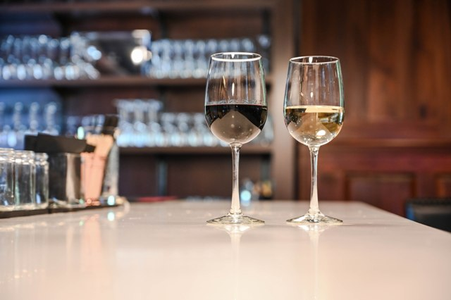 This is a photo of two wine glasses on the new white bar top at The Federal Restaurant.
