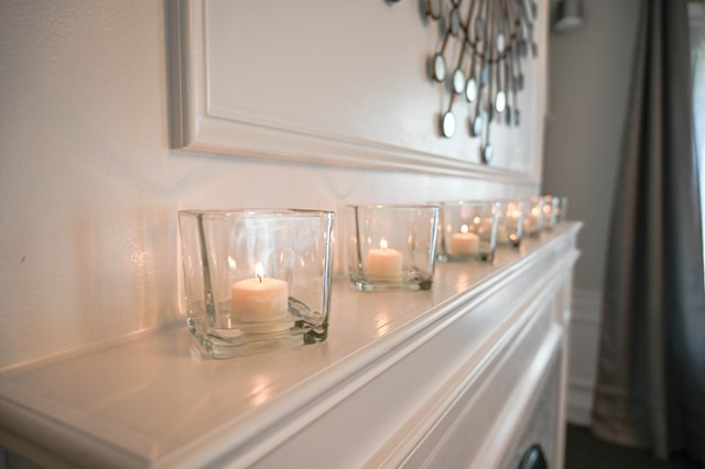 This is a photo of the candles lined up on the mantle in the Illingsworth room.